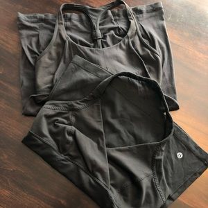 2 black Lululemon workout tops